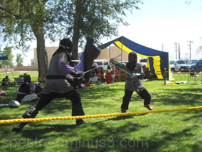 Fencers dueling at an SCA pratice.