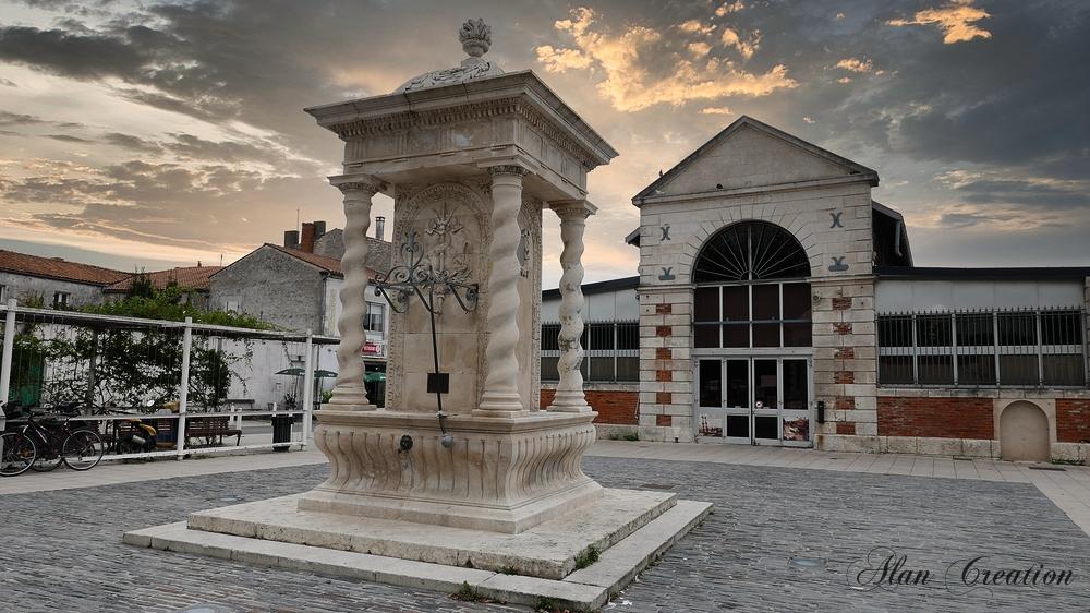 Les halles et la fontaine