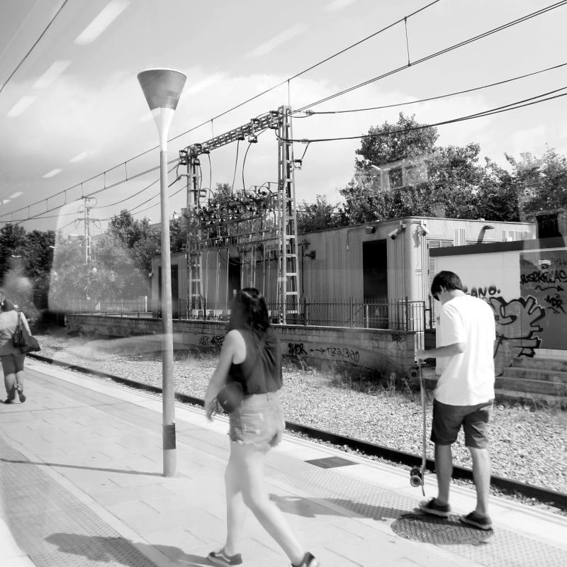Monochrome train platform shot taken from window.