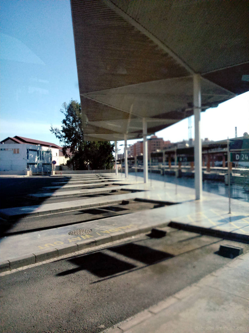 Waiting at a bus stop in Almería, Spain; view.