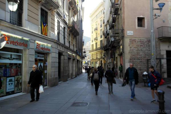 Barcelona, winter, street, people walking briskly.