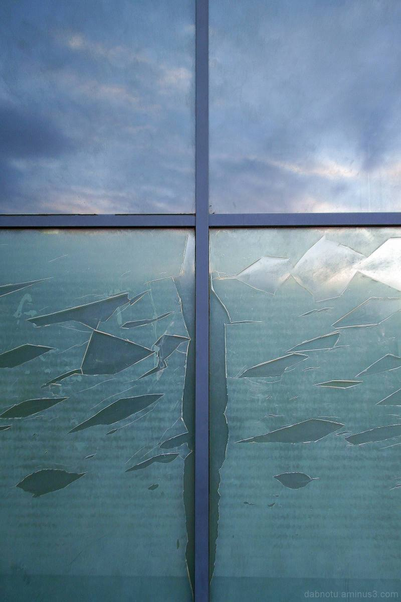 Raval/Barcelona glass panel reflection, morning.