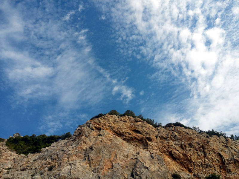 Picture of a cliff and sky looking up slight edit.