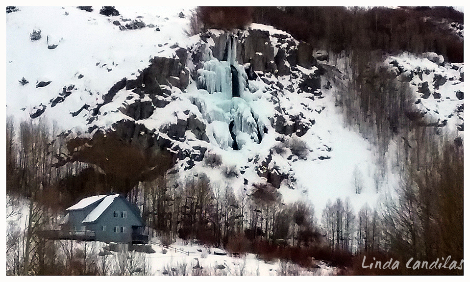Cabin and Frozen Waterfall