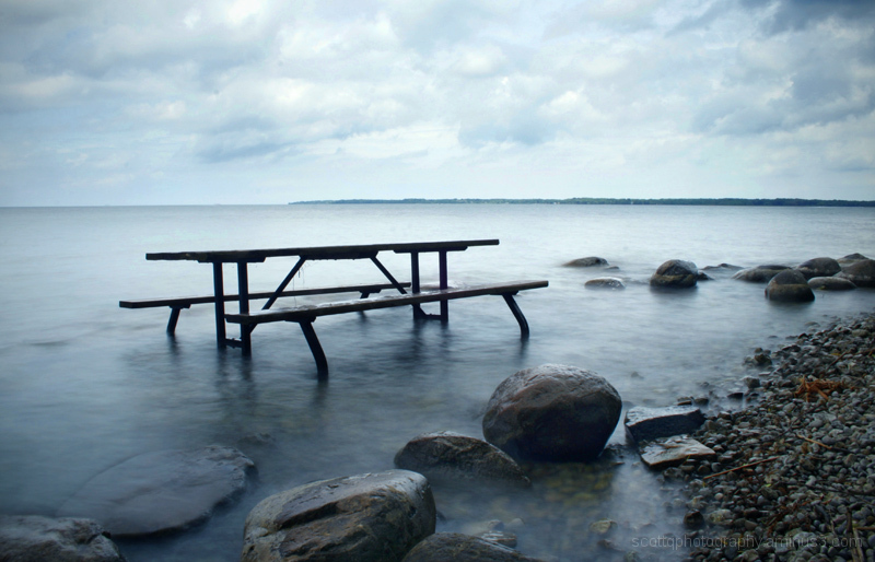A picnic table partially submerged in the lake