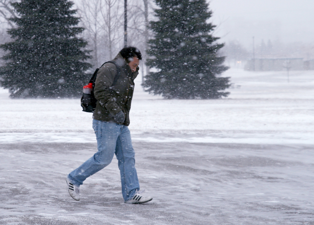 A person walking on a cold snowy day