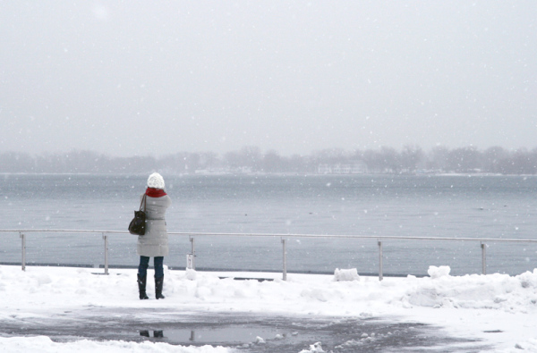 Woman looking across the lake