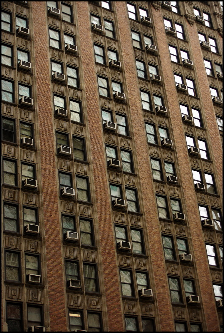 Regular pattern of ACU's on a building in NYC