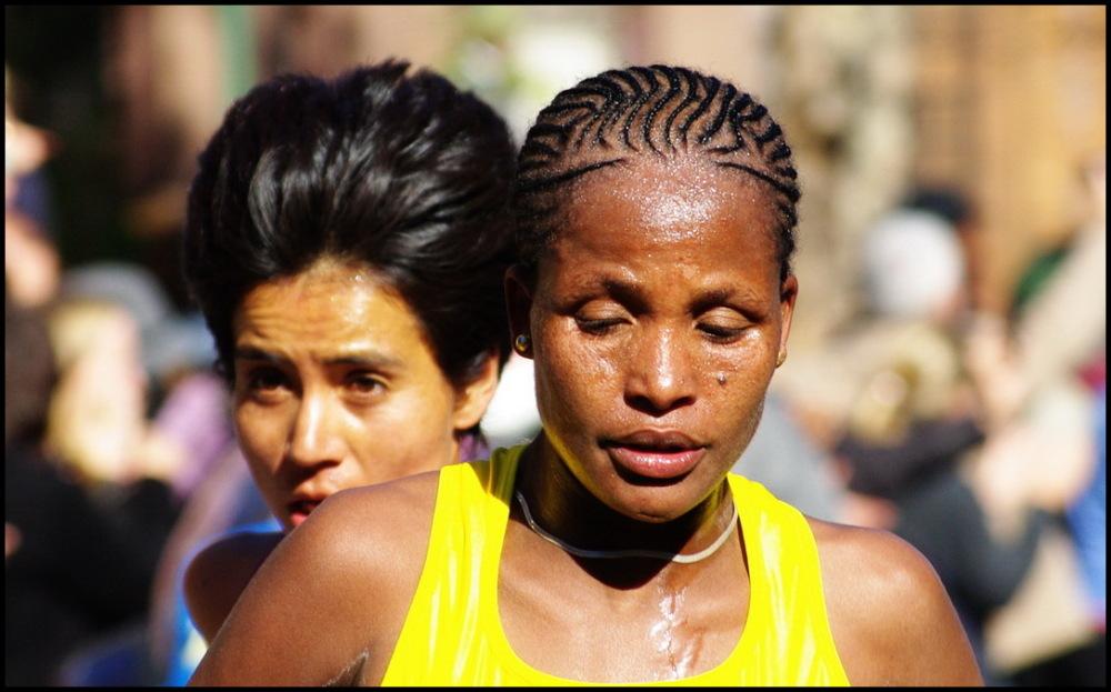 Two women running the 2010 New York marathon
