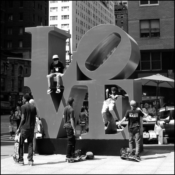 Boys playing around the Love sculpture in NYC