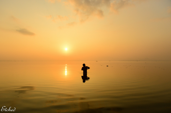 Taking a dip in the calm waters of Kolavai..