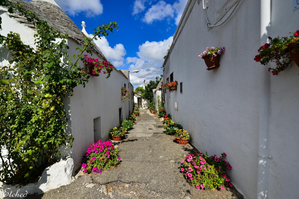 Colorful narrow streets of Alberobello, Italy