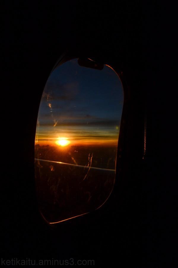 Sunrise, behind a window pane
