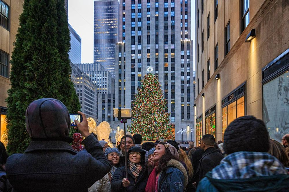 Taking Selfies by the tree in Rockefeller Center