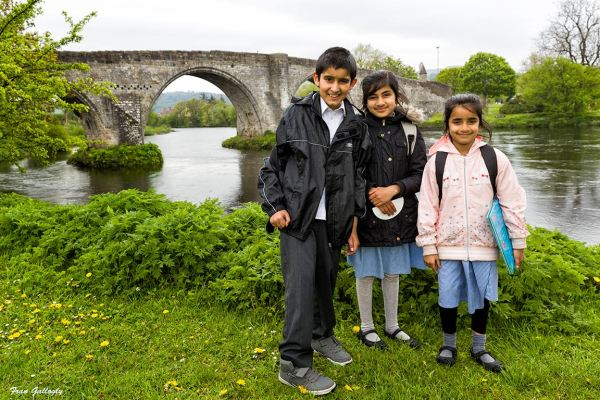 Stirling school children by old medieval bridge