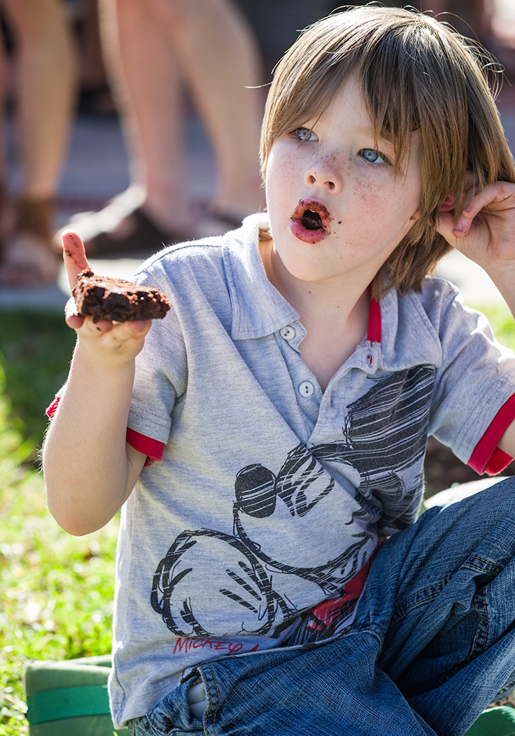 Child eating brownie at farmers market, florida