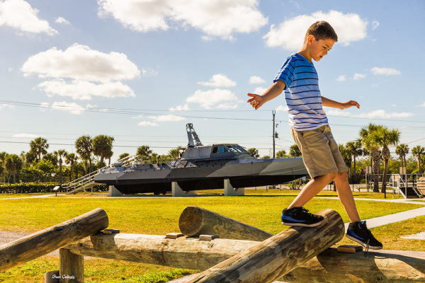 child on obstacle course at Navy SEAL Museum, FL