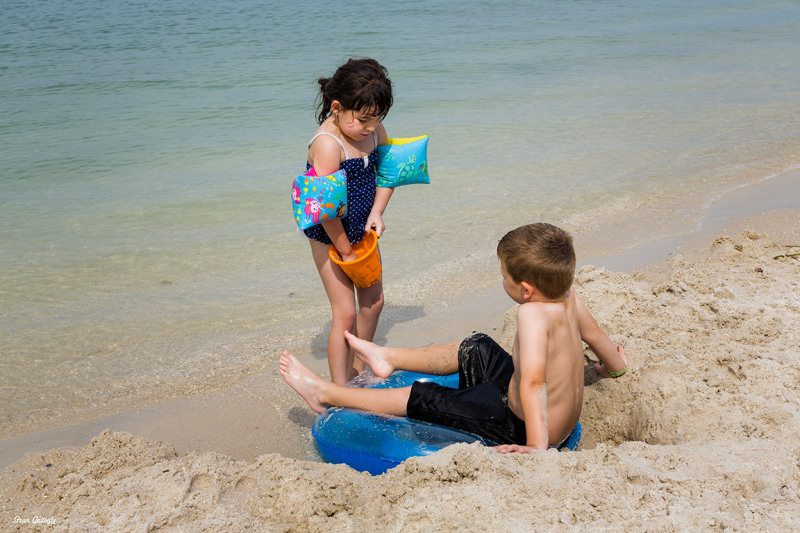 children playing in the sand on a beach, florida