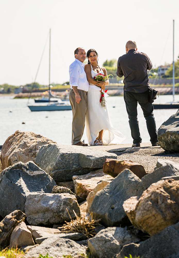 Wedding photographer and newlyweds at beach, CT