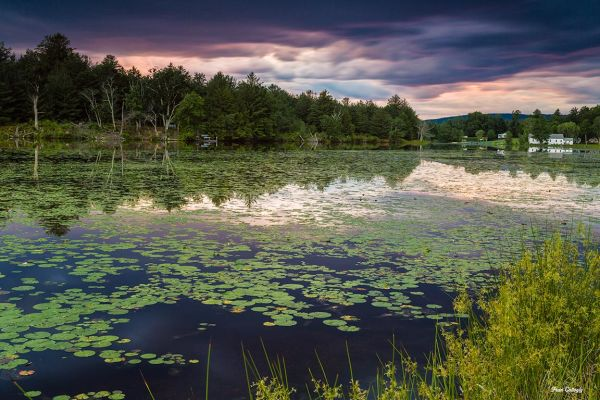 sunsetstorm clouds over a lake in ulster county ny