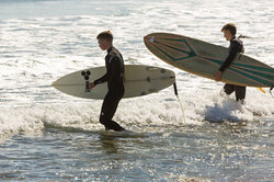 Surfers at Mansion Beach on Block Island, Rhode Is