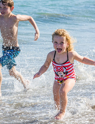 Children playing in the water on a florida beach