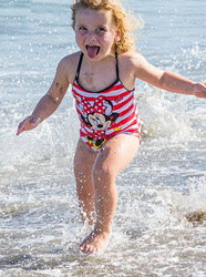 Child at the beach having fun in the surf, Florida