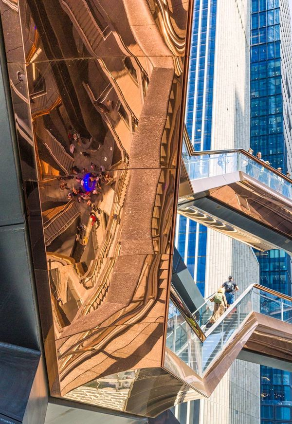 Reflections on floors of vessel, hudson yards, nyc