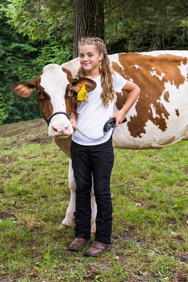 Child shows her cow in a competition at the Graham