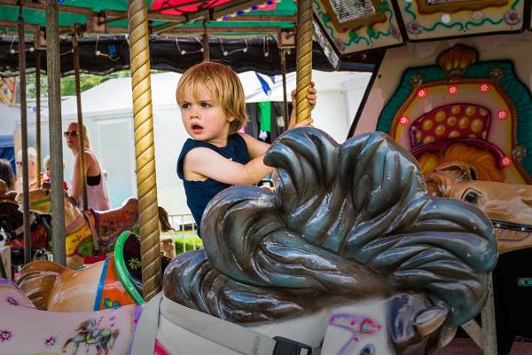 Carousel rider at fair, Grahamsville, NY
