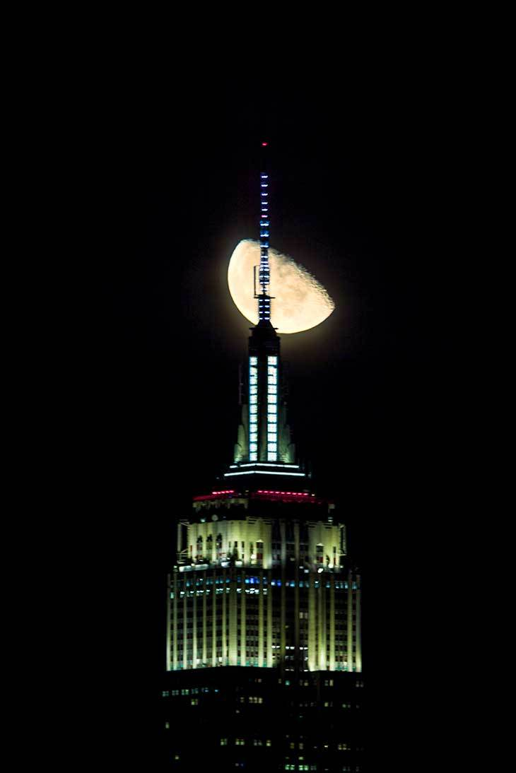 Moon over the Empire State Building, NYC.