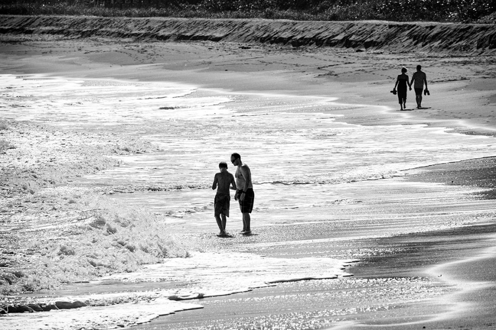 By the Sea, swimmers and strollers at beach, FL