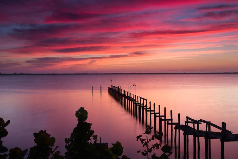 Sunrise over pier on Indian River Florida