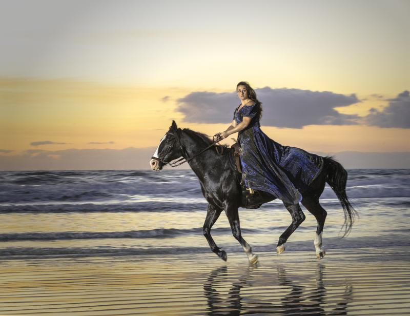riding on the beach at dawn