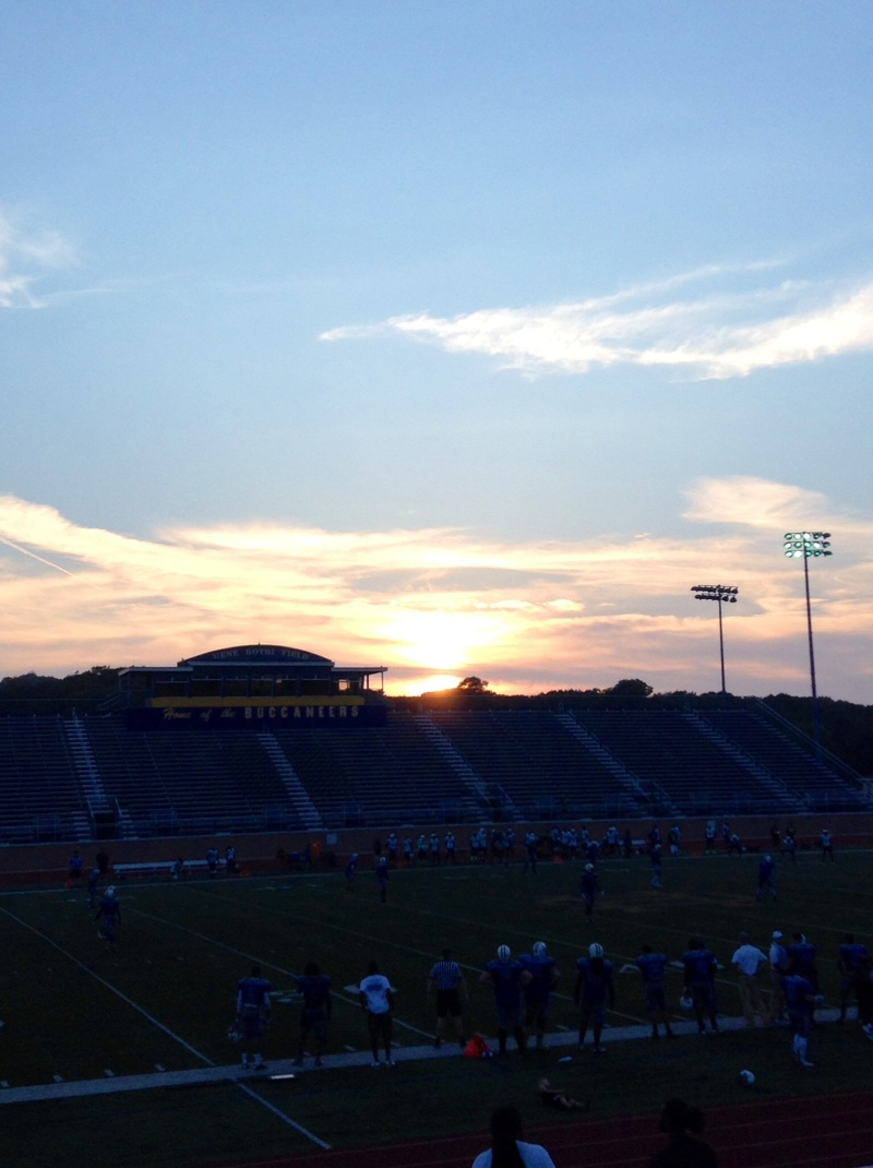 The sunset over the football field
