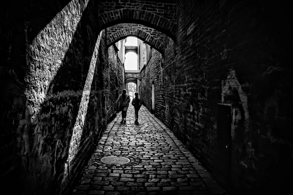 people, lane, street, brick, light, shadow