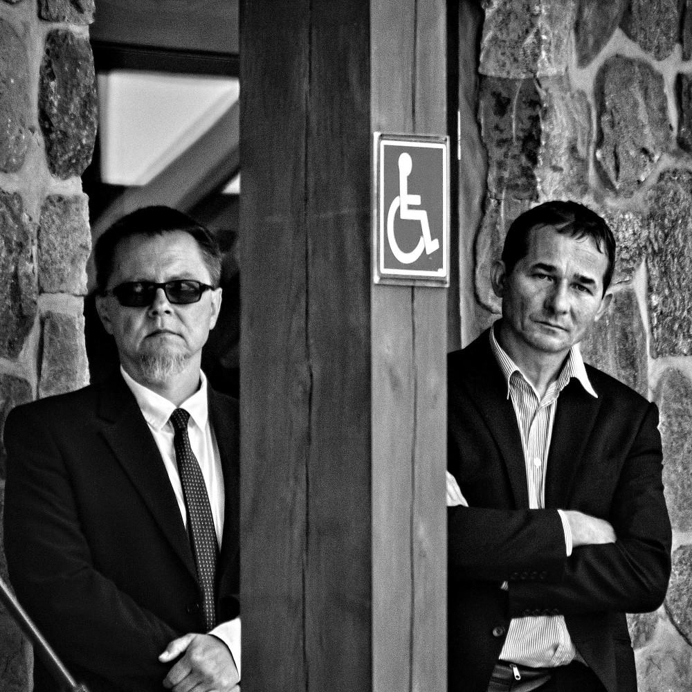Two Men In Black