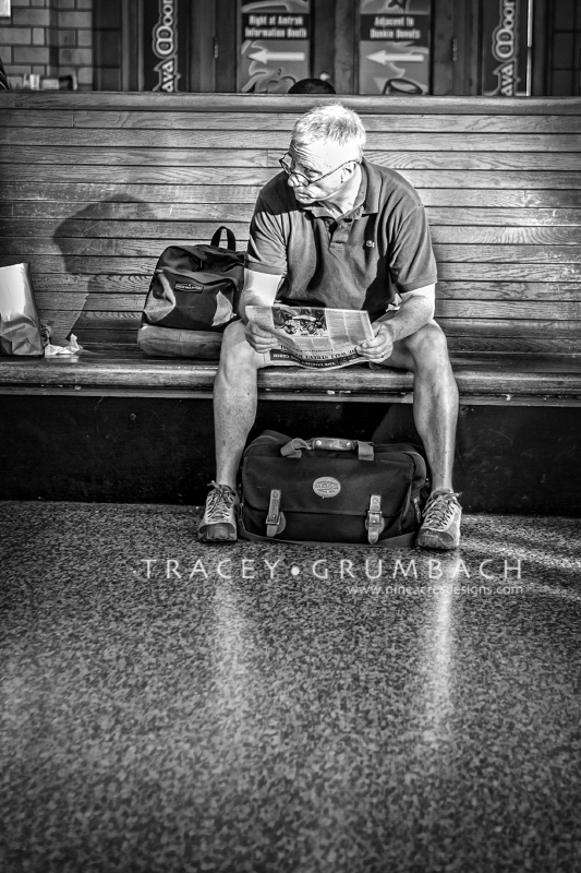 man waiting at a train station