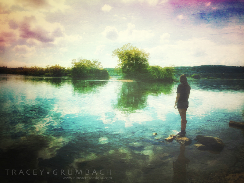 girl standing on rocks in a river