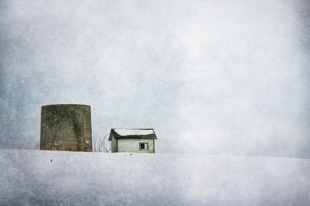 old silo in a snowy field
