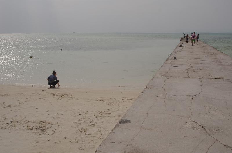 2008 classmate on crowded beach.