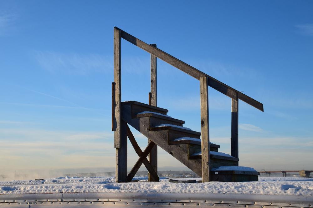steps on dock against blue sky