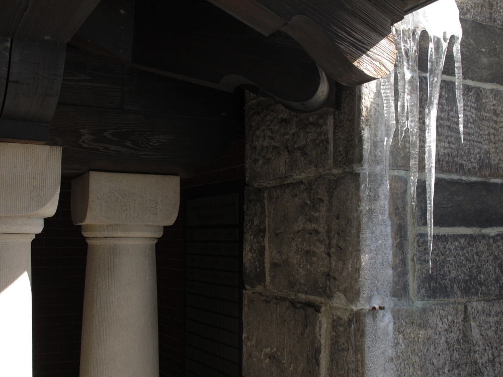a corner of covered colonaded walkway with icicles