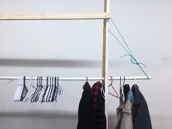 temporary coat rack against white wall