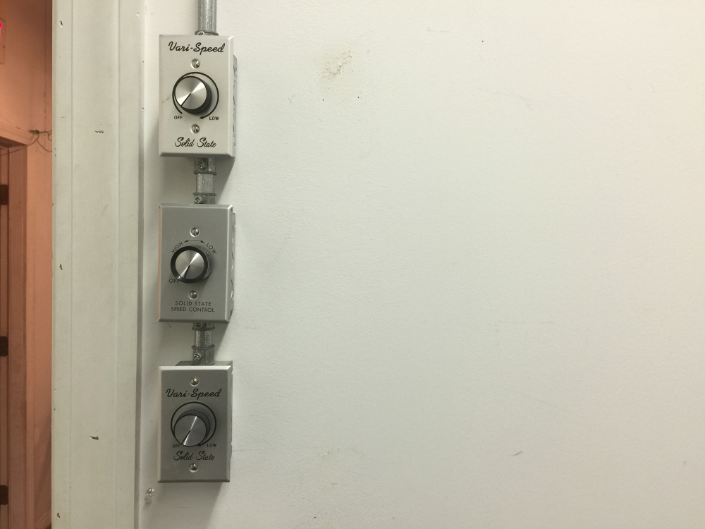 3 hinges and 3 controllers on white wall