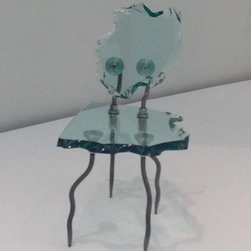 A piece of whole glass cut into a unqiue chair