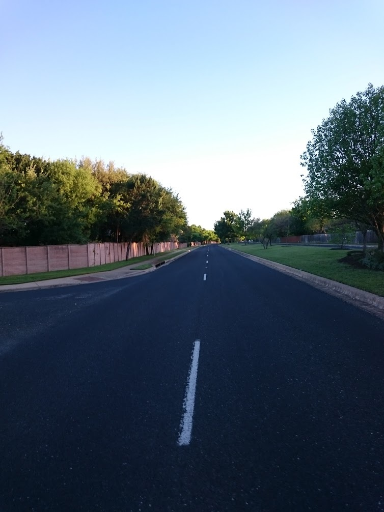 A view of a suburban road in a neighborhood