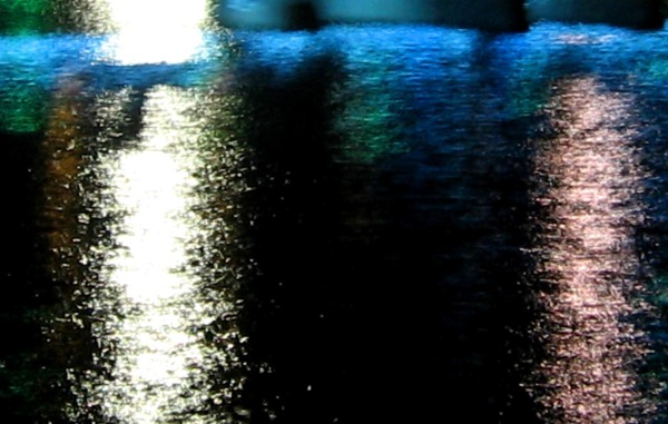 abstract reflection of light on dark blue water
