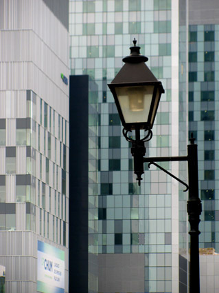 lamp framed with modern builings