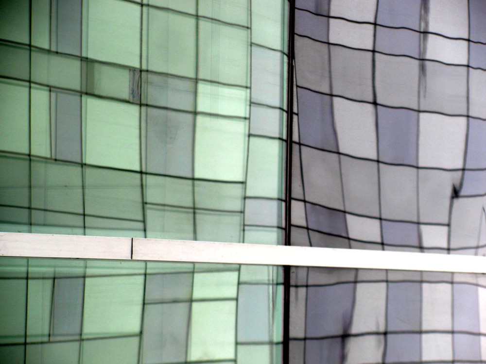abstract reflection of glass builing in windows